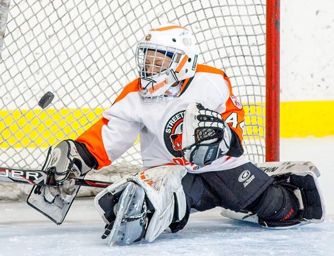 Streetsville Hockey Goalie stopping a goal